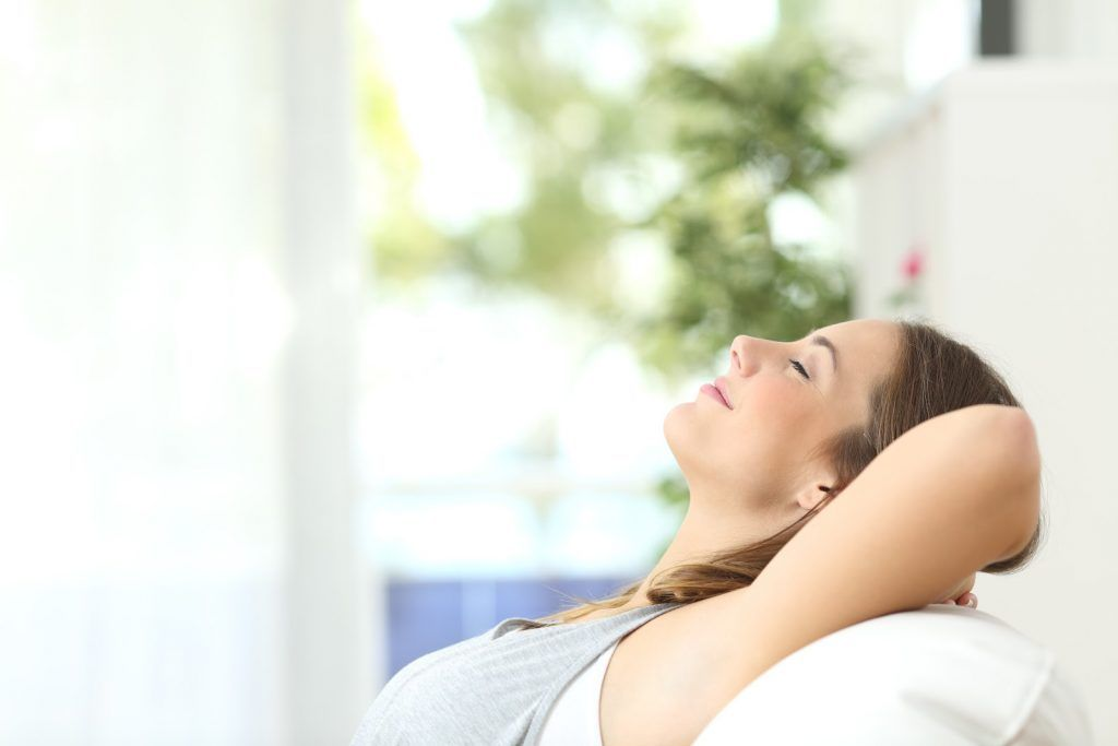 woman enjoying Air Cleaners: Simple indoor air quality tips you can get started with today!