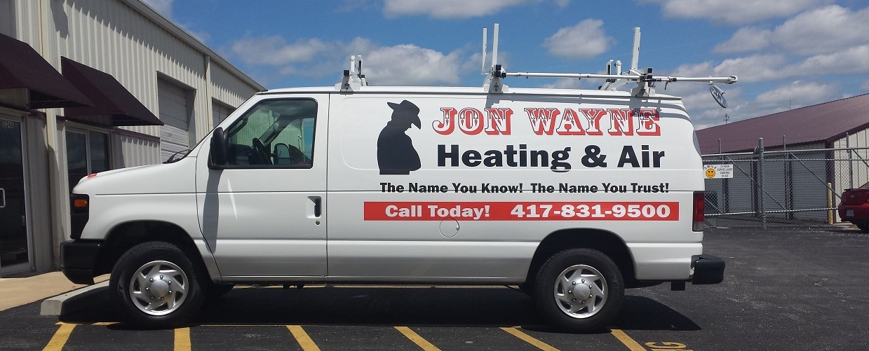 Jon Wayne Heating & Air van parked outside Springfield Missouri shop