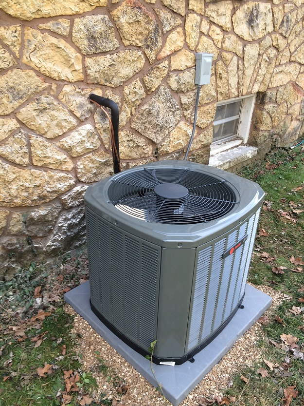 AC unit serviced by Jon Wayne Heating & Air at a home in Springfield, Missouri, making sure to have the proper ac size for your space