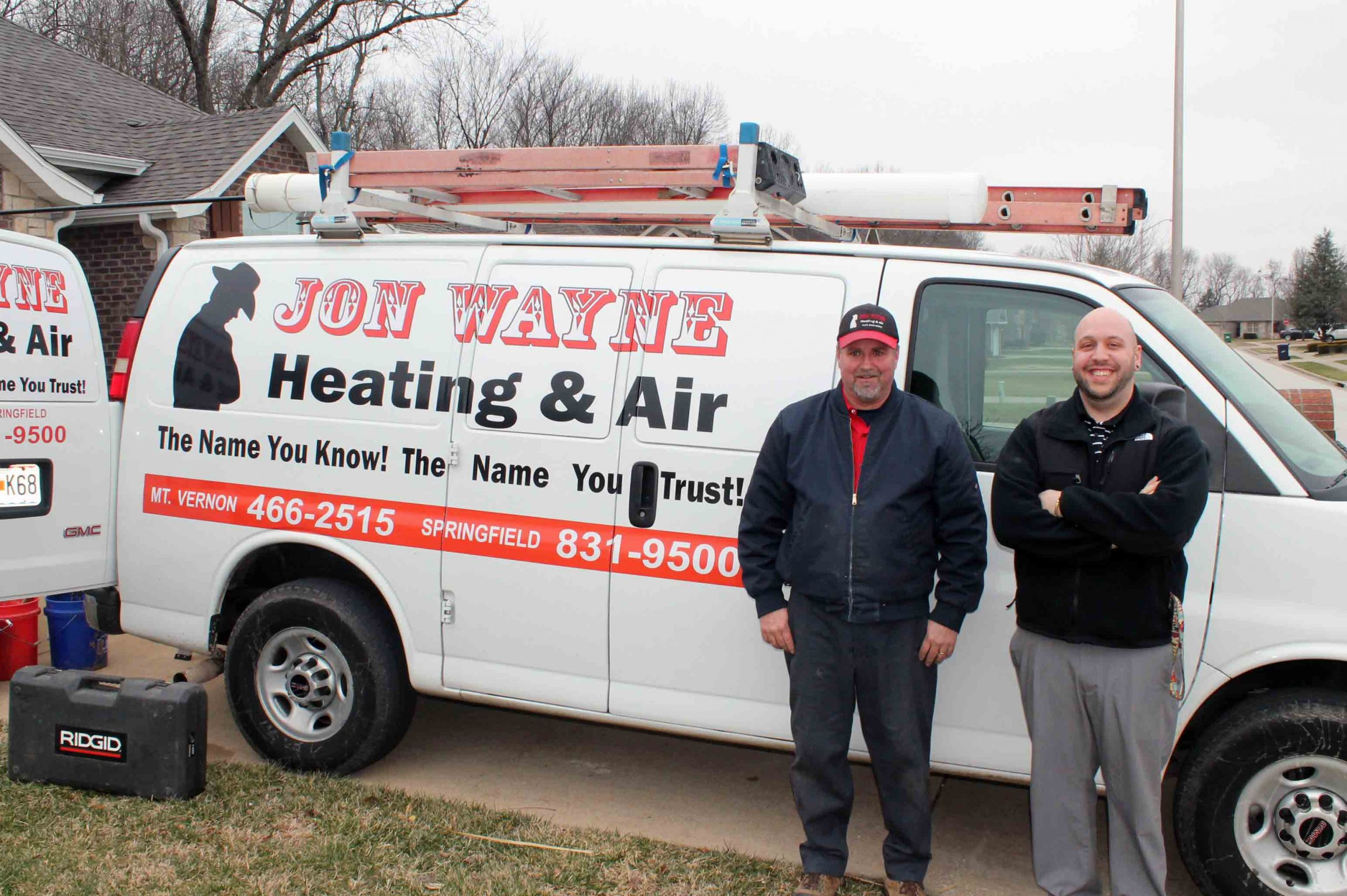 Jon Wayne co-owner and tech in front of HVAC van in Mt Vernon
