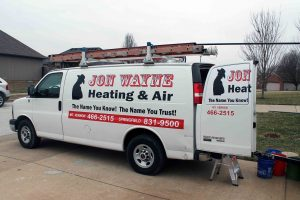 Jon Wayne van technician unloading furnace repair equipment
