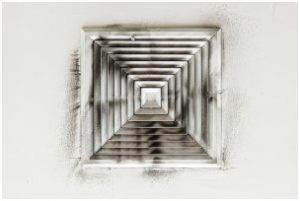 Dirty ceiling air vent, an obvious sign that now is the time to clean the air ducts