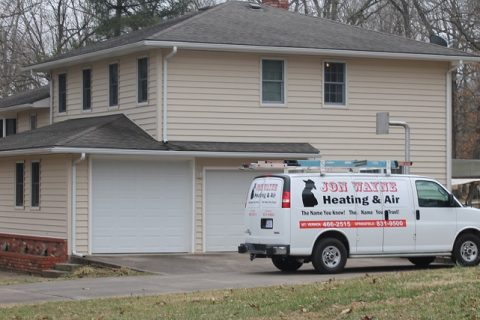 Jon Wayne Heating & Air HVAC van parked outside Springfield, MO home