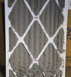 Very dirty air filter that caused an AC unit to freeze up with ice